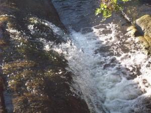 running-water-over-rocks